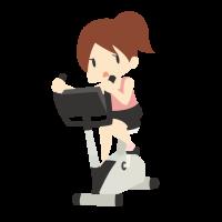 エアロバイクで有酸素運動をしている女性