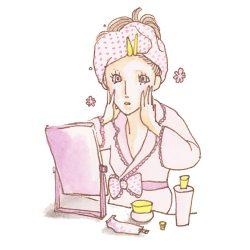お風呂上りにスキンケアしている女性の画像