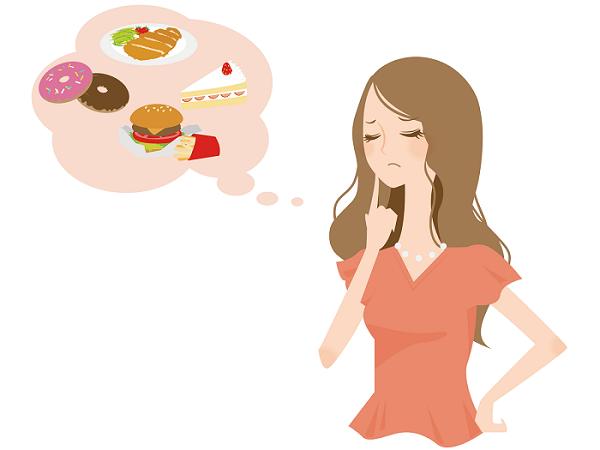 食欲を抑えられない女性の画像